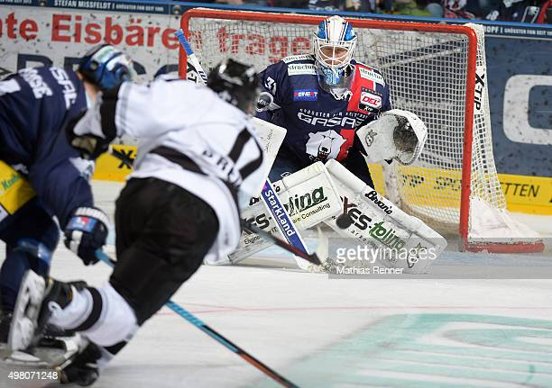 Patrick Reimer of the Thomas Sabo Ice Tigers Nuernberg and Petri Vehanen of the Eisbaeren Berlin during the game between the Eisbaeren Berlin and the...