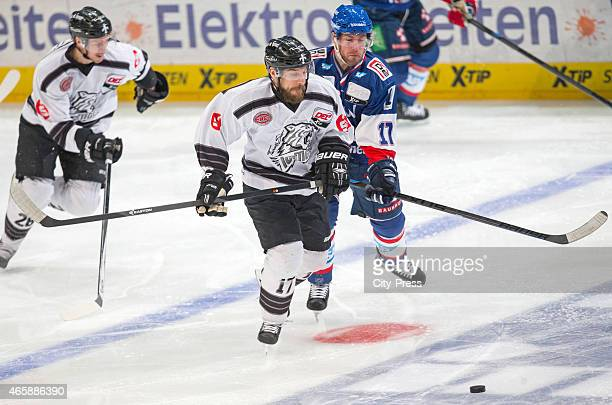 Patrick Reimer of the Thomas Sabo Ice Tigers Nuernberg handles the puck against Marcus Kink of the Adler Mannheim during the game between Adler...