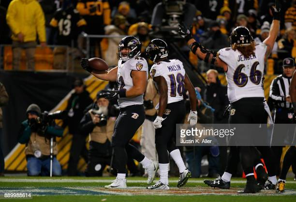 Patrick Ricard of the Baltimore Ravens reacts after a 6 yard touchdown reception in the third quarter during the game against the Pittsburgh Steelers...