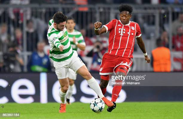 Patrick Roberts of Celtic and David Alaba of Bayern Muenchen battle for possession during the UEFA Champions League group B match between Bayern...