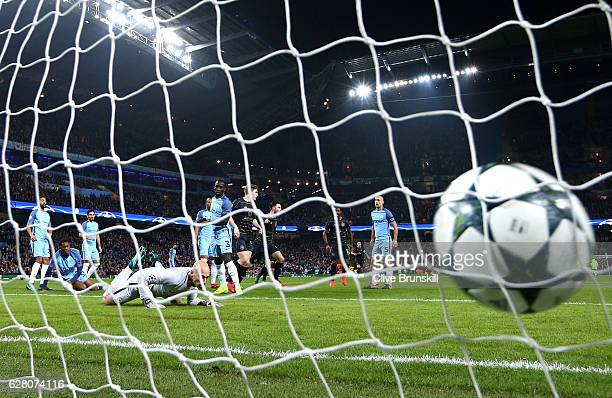 Patrick Roberts of Celtic scores his sides first goal past Willy Cabellero of Manchester City during the UEFA Champions League Group C match between...