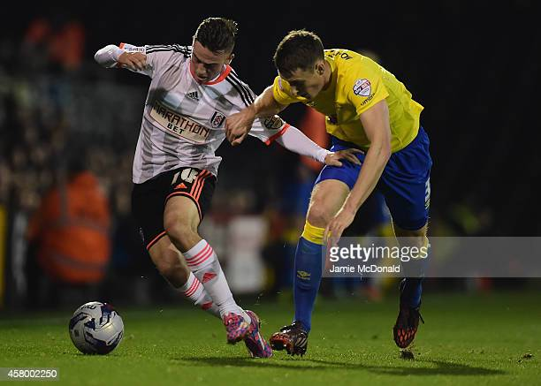 Patrick Roberts of Fulham battles with Craig Forsyth of Derby County during the Capital One Cup fourth round match between Fulham Derby County at...