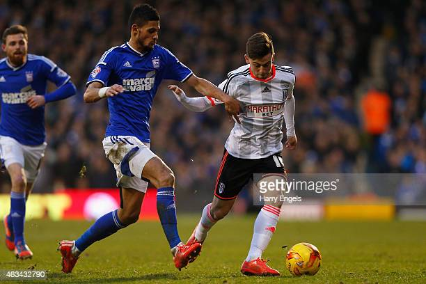 Patrick Roberts of Fulham is challenged by Kevin Bru of Ipswich Town during the Sky Bet Championship match between Fulham and Ipswich Town at Craven...