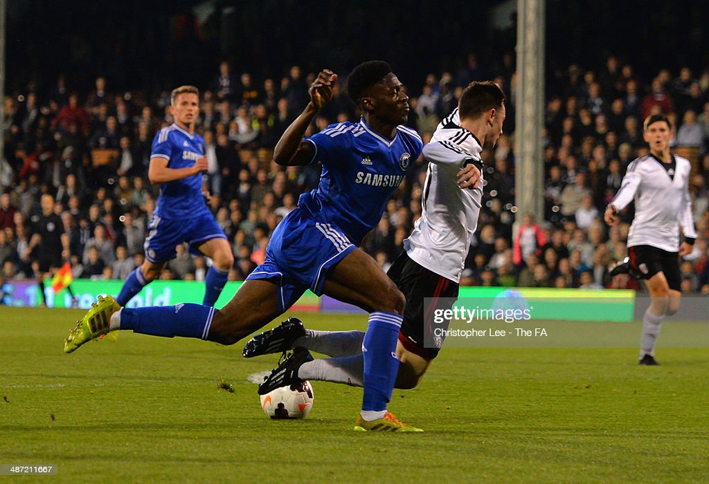 Patrick Roberts of Fulham is fouled in the area by Ola Aina of Chelsea for a penalty during the FA Youth Cup Final First Leg match between Fulham U18 and Chelsea U18 at Craven Cottage on April 28, 2014 in London, England.