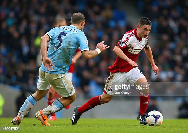 Patrick Roberts of Fulham is tracked by Pablo Zabaleta of Manchester City during the Barclays Premier League match between Manchester City and Fulham...