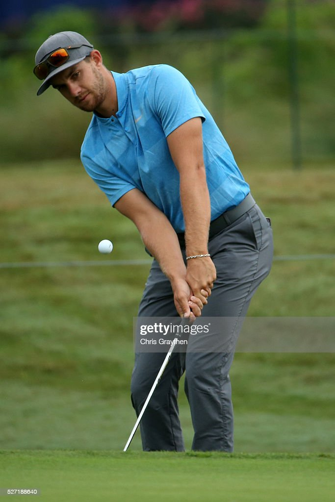Patrick Rodgers hits onto the 7th green during a continuation of the third round of the Zurich Classic at TPC Louisiana on May 2, 2016 in Avondale, Louisiana.