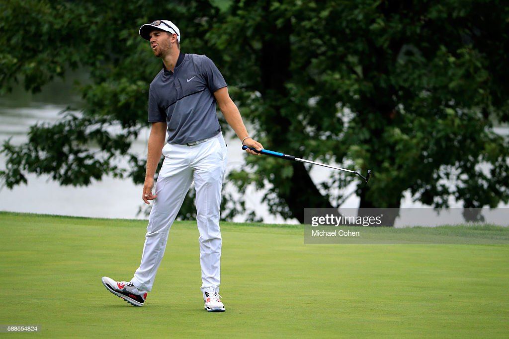 Patrick Rodgers reacts to his shot on the 16th hole during the first round of the John Deere Classic at TPC Deere Run on August 11 2016 in Silvis...