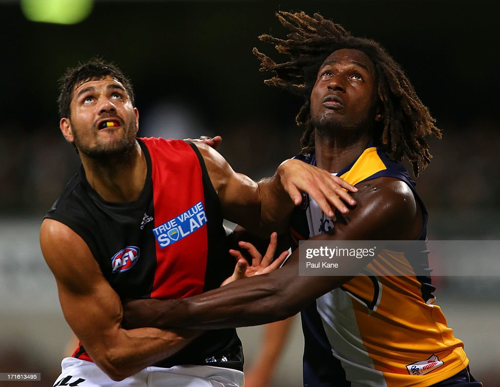 Patrick Ryder of the Bombers and <a gi-track='captionPersonalityLinkClicked' href=/galleries/search?phrase=Nic+Naitanui&family=editorial&specificpeople=6577611 ng-click='$event.stopPropagation()'>Nic Naitanui</a> of the Eagles contest the ruck during the round 14 AFL match between the West Coast Eagles and the Essendon Bombers at Patersons Stadium on June 27, 2013 in Perth, Australia.