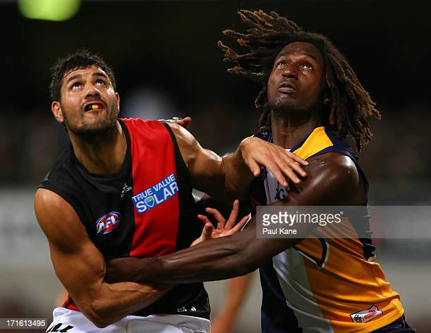 Patrick Ryder of the Bombers and Nic Naitanui of the Eagles contest the ruck during the round 14 AFL match between the West Coast Eagles and the...