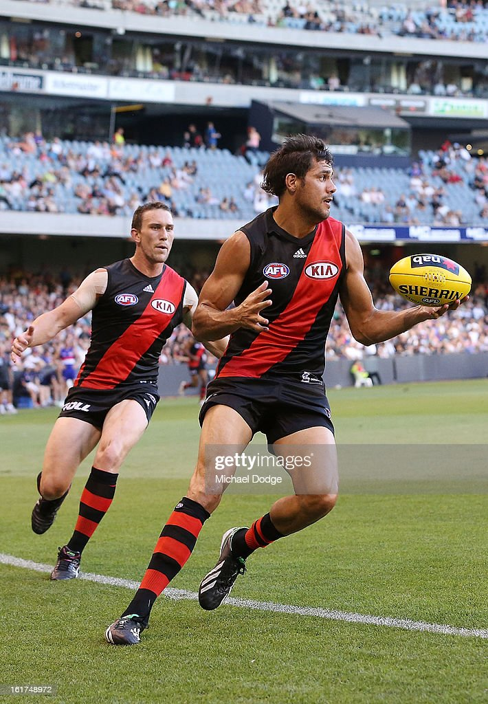 Patrick Ryder of the Essendon Bombers runs with the ball during the round one AFL NAB Cup match between the Essendon Bombers and the Western Bulldogs at Etihad Stadium on February 15, 2013 in Melbourne, Australia.