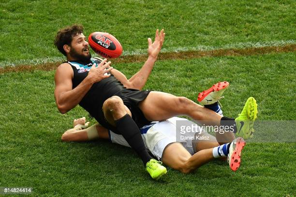 Patrick Ryder of the Power marks the ball over Lindsay Thomas of the Kangaroos during the round 17 AFL match between the Port Adelaide Power and the...