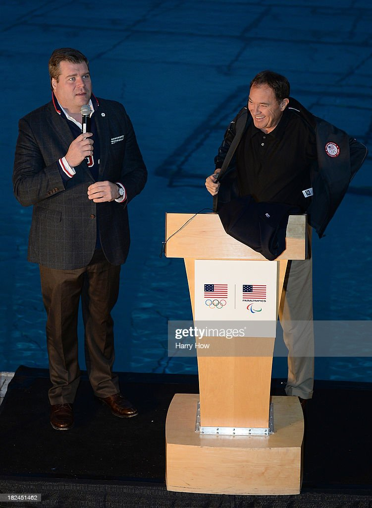 Patrick Sandusky, Chief Communications and Public Affairs Officer for the United States Olympic Committee presents a United States Team podium jacket to Governor of Utah, Gary Herbert during the Team USA media summit opening reception at Utah Olympic Park on September 29, 2013 in Park City, Utah.