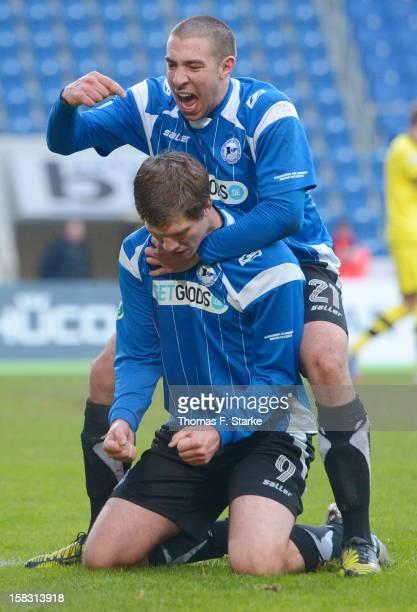 Patrick Schoenfeld and Fabian Klos celebrate a goal during the Third League match between Arminia Bielefeld and Borussia Dortmund II at Schueco Arena...