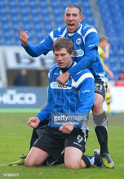 Patrick Schoenfeld and Fabian Klos celebrate during the Third League match between Arminia Bielefeld and Borussia Dortmund II at Schueco Arena on...