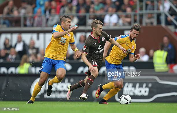 Patrick Schoenfeld of Braunschweig and Christopher Buchtmann of Pauli and Quirin Moll of Braunschweig battle for the ball during the Second...