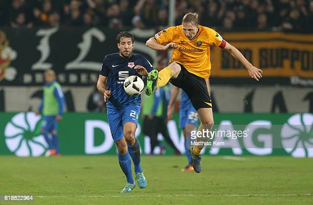 Patrick Schoenfeld of Braunschweig battles for the ball with Marco Hartmann of Dresden during the Second Bundesliga match between SG Dynamo Dresden...