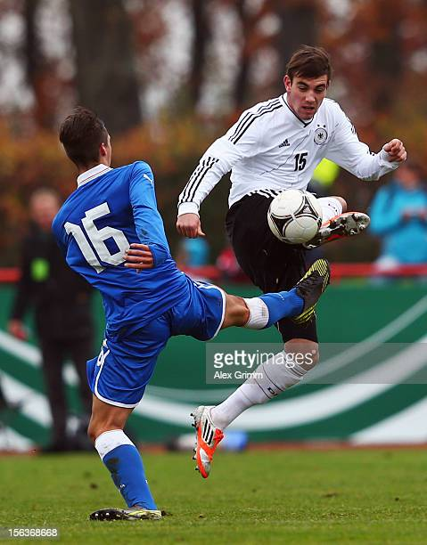 Patrick Schwarz of Germany is challenged by Alberto Rosa Gastaldo of Italy during the U18 international friendly match between Germany and Italy at...