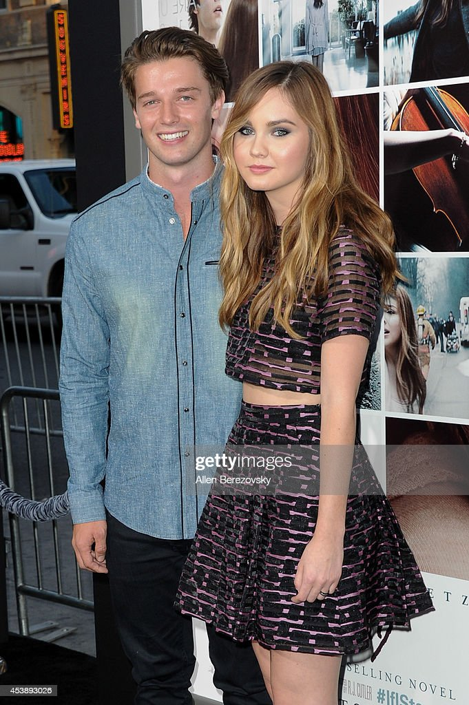 Patrick Schwarzenegger and actress Liana Liberato arrive at the Los Angeles Premiere of 'If I Stay' at TCL Chinese Theatre on August 20, 2014 in Hollywood, California.