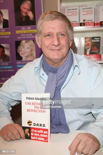 Patrick Sebastien signs copies of his book 'Une revolte pas une revolution' at the 30th salon du livre at Porte de Versailles on March 28 2010 in...