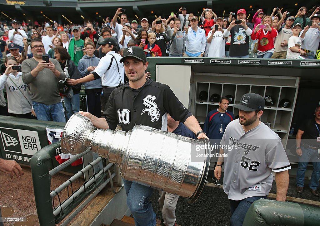 Patrick Sharp #10 and Brandon Bollig #52 of the Chicago Blackhawks make an appearance with the Stanley Cup before the Chicago White Sox take on the Baltimore Orioles at U.S. Cellular Field on July 3, 2013 in Chicago, Illinois.