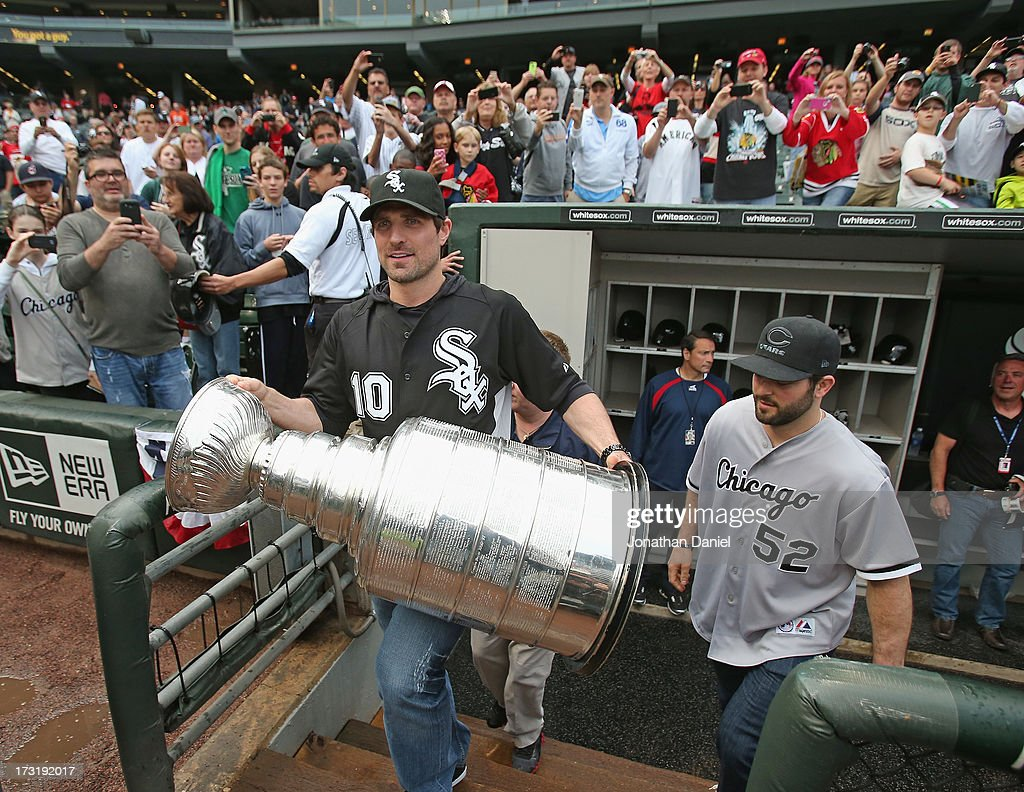 <a gi-track='captionPersonalityLinkClicked' href=/galleries/search?phrase=Patrick+Sharp&family=editorial&specificpeople=206279 ng-click='$event.stopPropagation()'>Patrick Sharp</a> #10 and <a gi-track='captionPersonalityLinkClicked' href=/galleries/search?phrase=Brandon+Bollig&family=editorial&specificpeople=7186858 ng-click='$event.stopPropagation()'>Brandon Bollig</a> #52 of the Chicago Blackhawks make an appearance with the Stanley Cup before the Chicago White Sox take on the Baltimore Orioles at U.S. Cellular Field on July 3, 2013 in Chicago, Illinois.