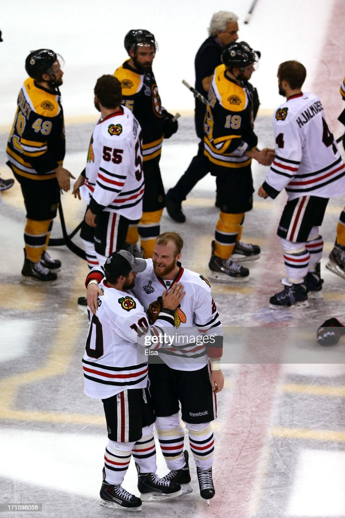 Patrick Sharp #10 and Bryan Bickell #29 of the Chicago Blackhawks celebrate a goal in the thrid period against the Boston Bruins in Game Six of the 2013 NHL Stanley Cup Final at TD Garden on June 24, 2013 in Boston, Massachusetts.