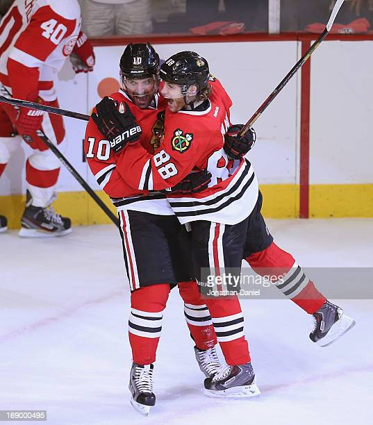 Patrick Sharp and Patrick Kane of the Chicago Blackhawks celebrate Kanes' first goal of the playoffs in the first period against the Detroit Red...