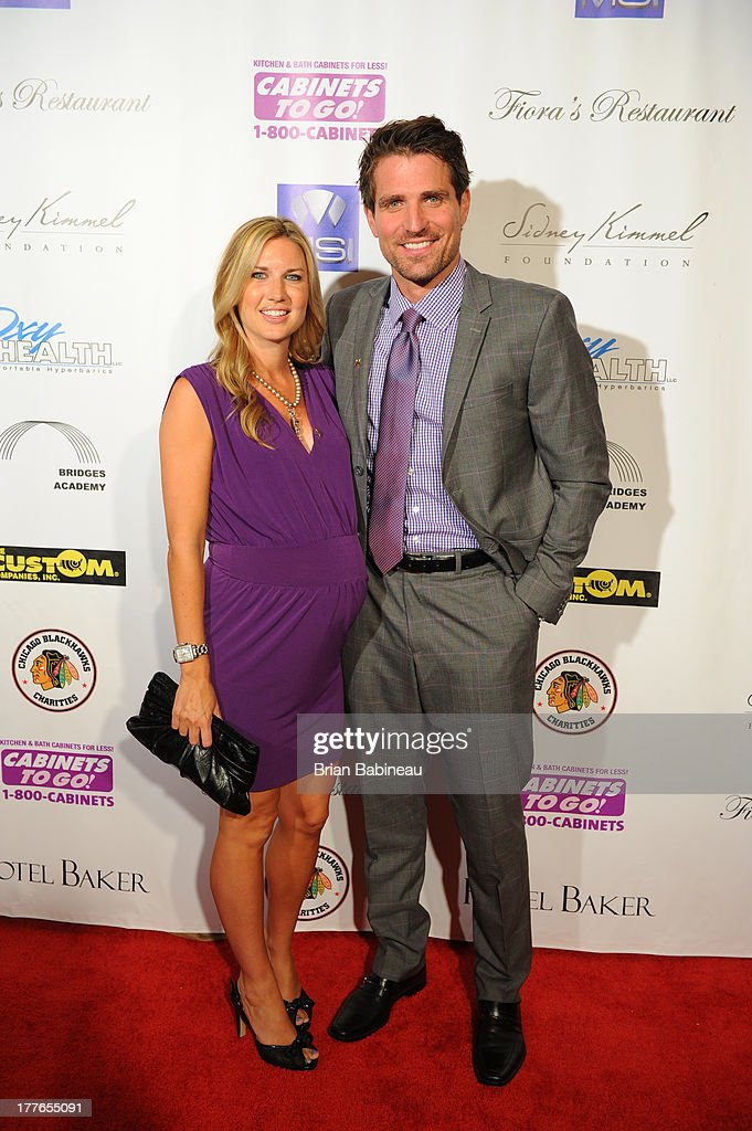 Patrick Sharp and wife Abby Sharp attend the Dancing with the Stars Charity event hosted by Jenny McCarthy on August 24, 2013 at Hotel Baker in St Charles, Illinois.