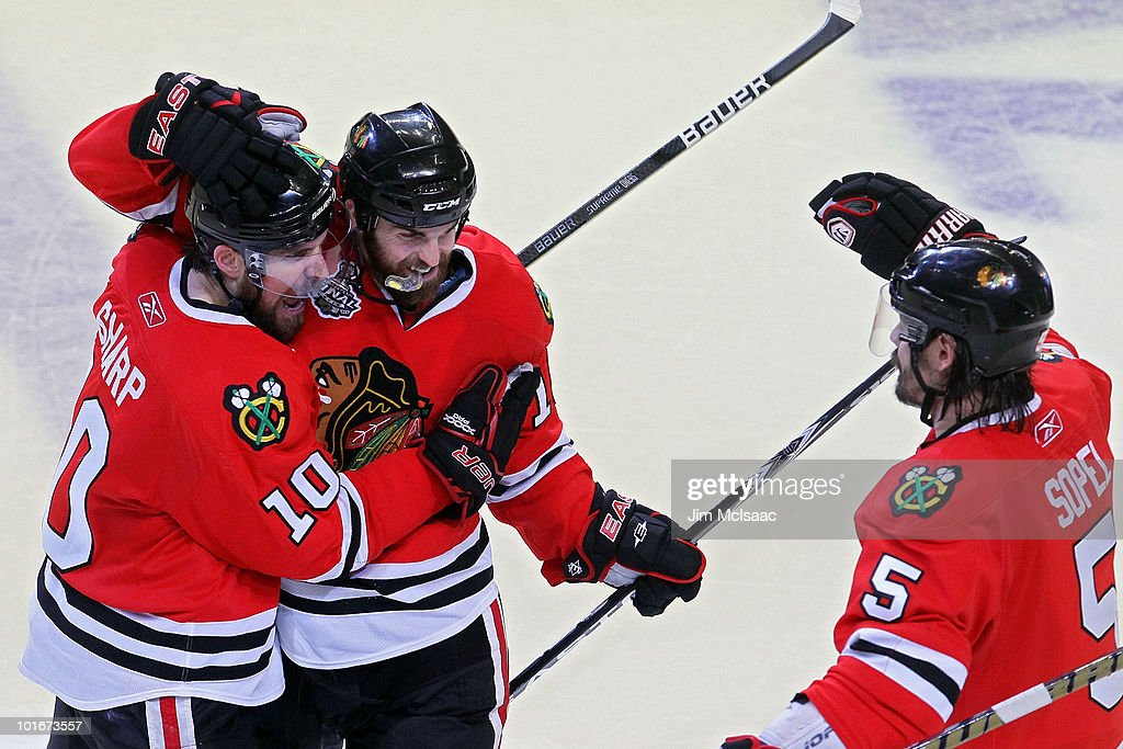 Patrick Sharp #10, Andrew Ladd #16 and Brent Sopel #5 of the Chicago Blackhawks celebrate after defeating the Philadelphia Flyers 7-4 in Game Five of the 2010 NHL Stanley Cup Final at the United Center on June 6, 2010 in Chicago, Illinois.
