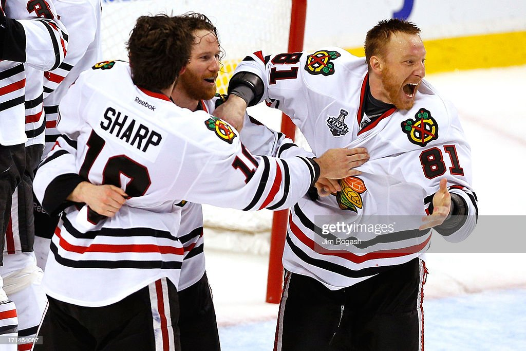 Patrick Sharp #10, Duncan Keith #2 and Marian Hossa #81 of the Chicago Blackhawks of the Chicago Blackhawks celebrate their 2-1 victory over the Boston Bruins in Game Six of the 2013 NHL Stanley Cup Final at TD Garden on June 24, 2013 in Boston, Massachusetts. The Chicago Blackhawks defeated the Boston Bruins 3-2.