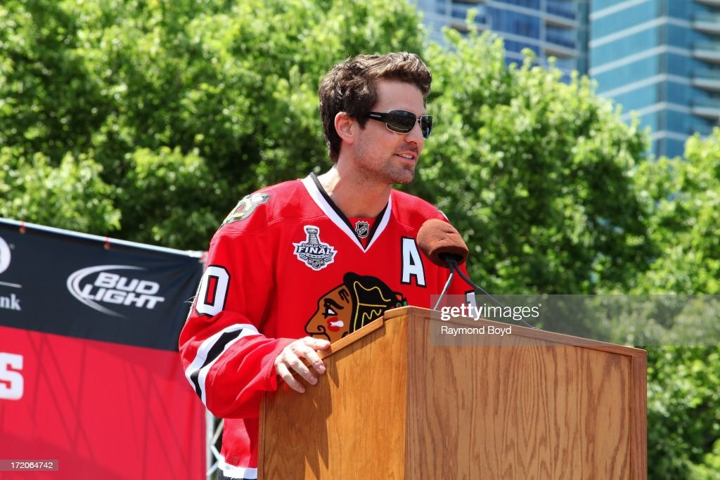 Patrick Sharp, forward for the Chicago Blackhawks, speaks during the Chicago Blackhawks' 2013 Stanley Cup Championship rally at Hutchinson Field in Grant Park in Chicago, Illinois on JUNE