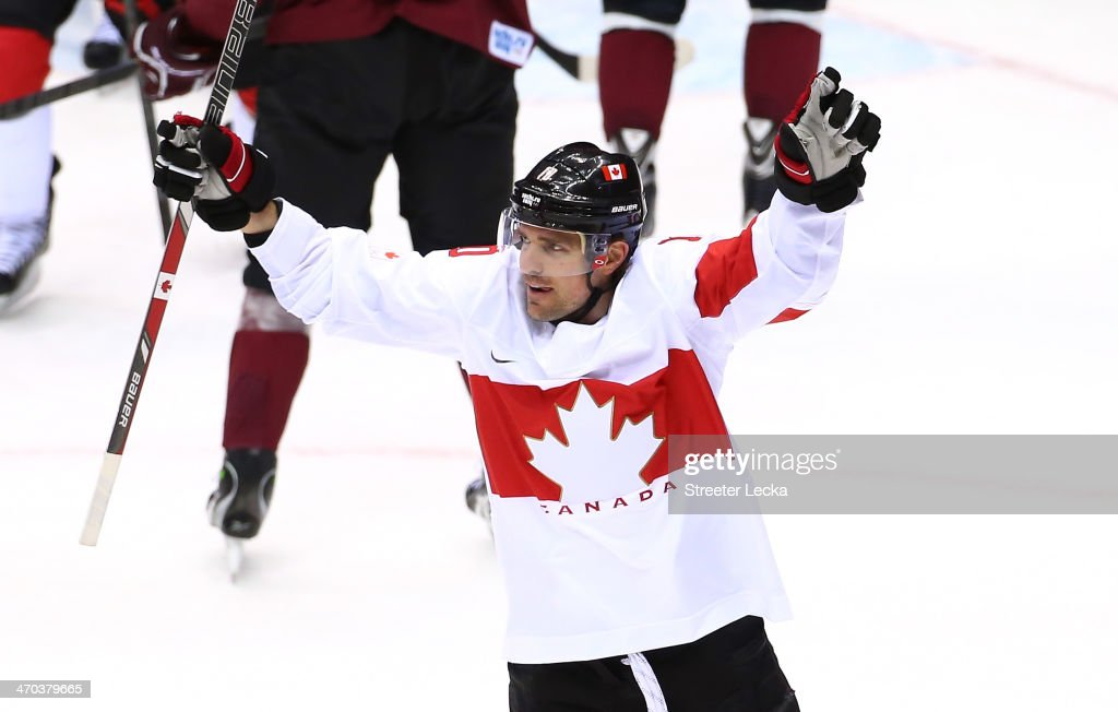 <a gi-track='captionPersonalityLinkClicked' href=/galleries/search?phrase=Patrick+Sharp&family=editorial&specificpeople=206279 ng-click='$event.stopPropagation()'>Patrick Sharp</a> #10 of Canada celebrates after scoring a first-period goal against Latvia during the Men's Ice Hockey Quarterfinal Playoff on Day 12 of the 2014 Sochi Winter Olympics at Bolshoy Ice Dome on February 19, 2014 in Sochi, Russia.