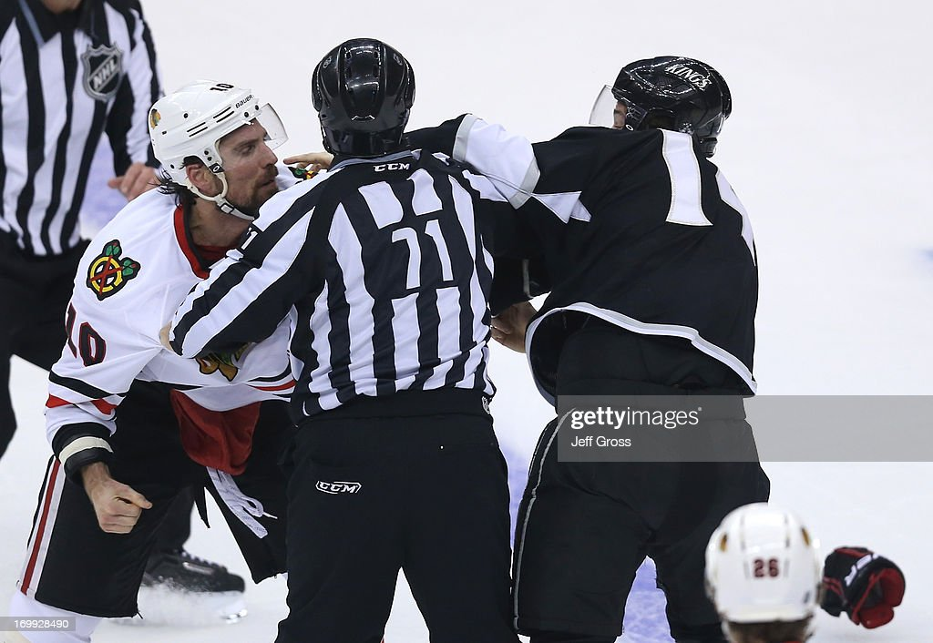 Patrick Sharp #10 of the Chicago Blackhawks and Justin Williams #14 of the Los Angeles Kings get in a scrum in the first period of Game Three of the Western Conference Final during the 2013 NHL Stanley Cup Playoffs at Staples Center on June 4, 2013 in Los Angeles, California.