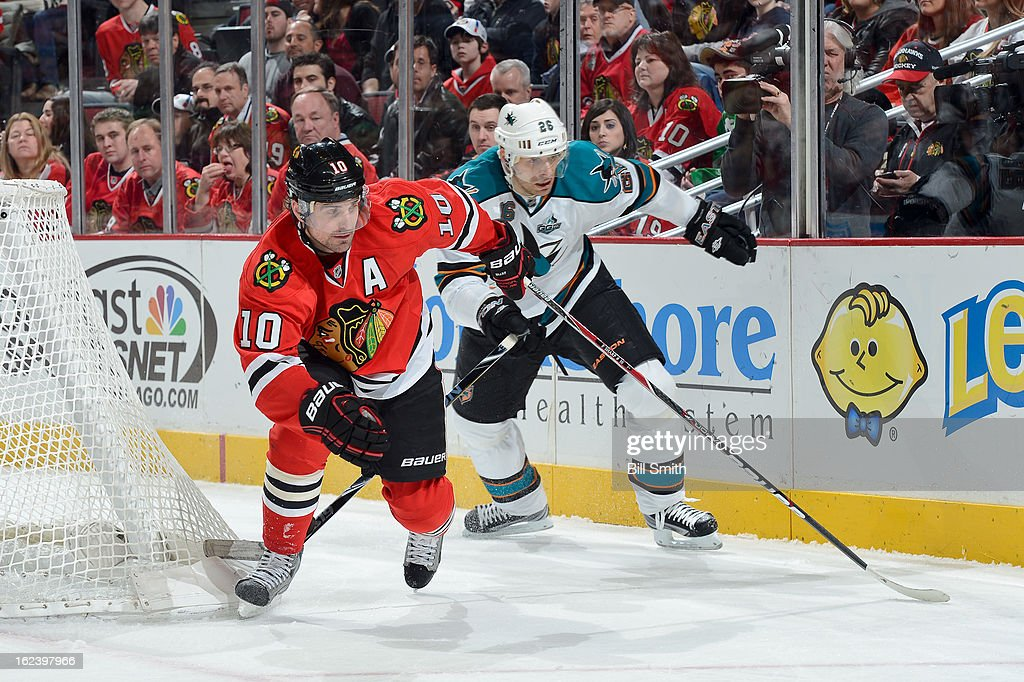 <a gi-track='captionPersonalityLinkClicked' href=/galleries/search?phrase=Patrick+Sharp&family=editorial&specificpeople=206279 ng-click='$event.stopPropagation()'>Patrick Sharp</a> #10 of the Chicago Blackhawks and <a gi-track='captionPersonalityLinkClicked' href=/galleries/search?phrase=Michal+Handzus&family=editorial&specificpeople=201537 ng-click='$event.stopPropagation()'>Michal Handzus</a> #26 of the San Jose Sharks skate around from behind the net during the NHL game on February 22, 2013 at the United Center in Chicago, Illinois.