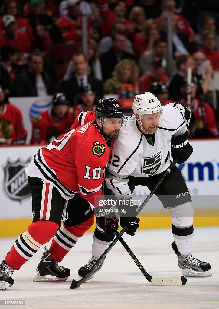 Patrick Sharp #10 of the Chicago Blackhawks and Trevor Lewis #22 of the Los Angeles Kings vie for position during a face off in the second period of Game Two of the Western Conference Final during the 2013 NHL Stanley Cup Playoffs at United Center on June 2, 2013 in Chicago, Illinois. The Blackhawks defeated the Kings 4-2.