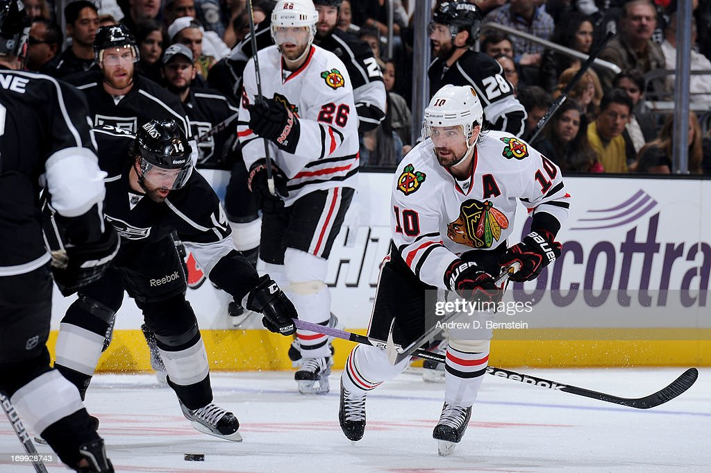 Patrick Sharp #10 of the Chicago Blackhawks battles for the puck against Justin Williams #14 of the Los Angeles Kings in Game Three of the Western Conference Final during the 2013 NHL Stanley Cup Playoffs at Staples Center on June 4, 2013 in Los Angeles, California.