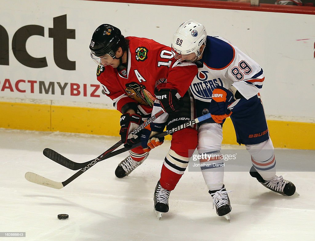 <a gi-track='captionPersonalityLinkClicked' href=/galleries/search?phrase=Patrick+Sharp&family=editorial&specificpeople=206279 ng-click='$event.stopPropagation()'>Patrick Sharp</a> #10 of the Chicago Blackhawks battles for the puck with <a gi-track='captionPersonalityLinkClicked' href=/galleries/search?phrase=Sam+Gagner&family=editorial&specificpeople=4042961 ng-click='$event.stopPropagation()'>Sam Gagner</a> #89 of the Edmonton Oilers at the United Center on February 25, 2013 in Chicago, Illinois.