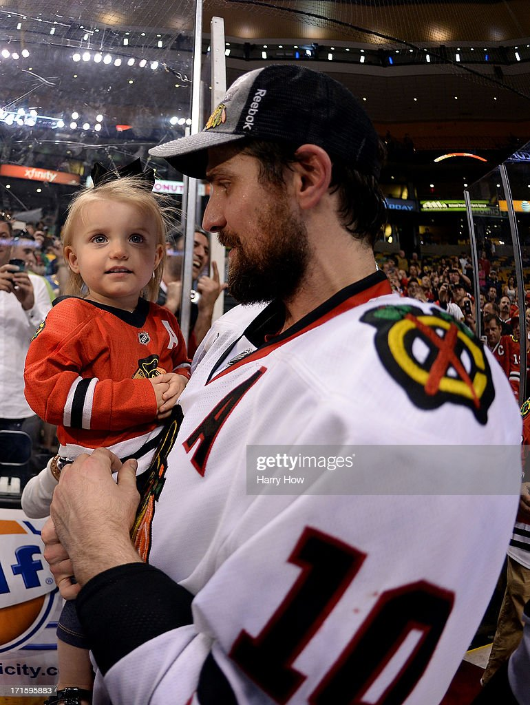 Patrick Sharp #10 of the Chicago Blackhawks celebrates a 2-1 victory over the Boston Bruins with his son and wife following Game Six of the 2013 NHL Stanley Cup Final at TD Garden on June 24, 2013 in Boston, Massachusetts.
