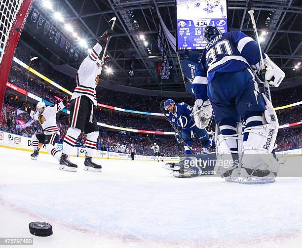 Patrick Sharp of the Chicago Blackhawks celebrates a goal by teammate Antoine Vermette against goalie Ben Bishop and the Tampa Bay Lightning during...