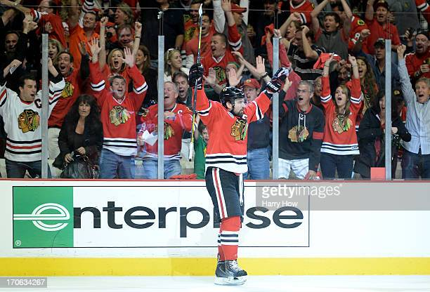 Patrick Sharp of the Chicago Blackhawks celebrates after scoring a goal in the first period against Tuukka Rask of the Boston Bruins in Game Two of...