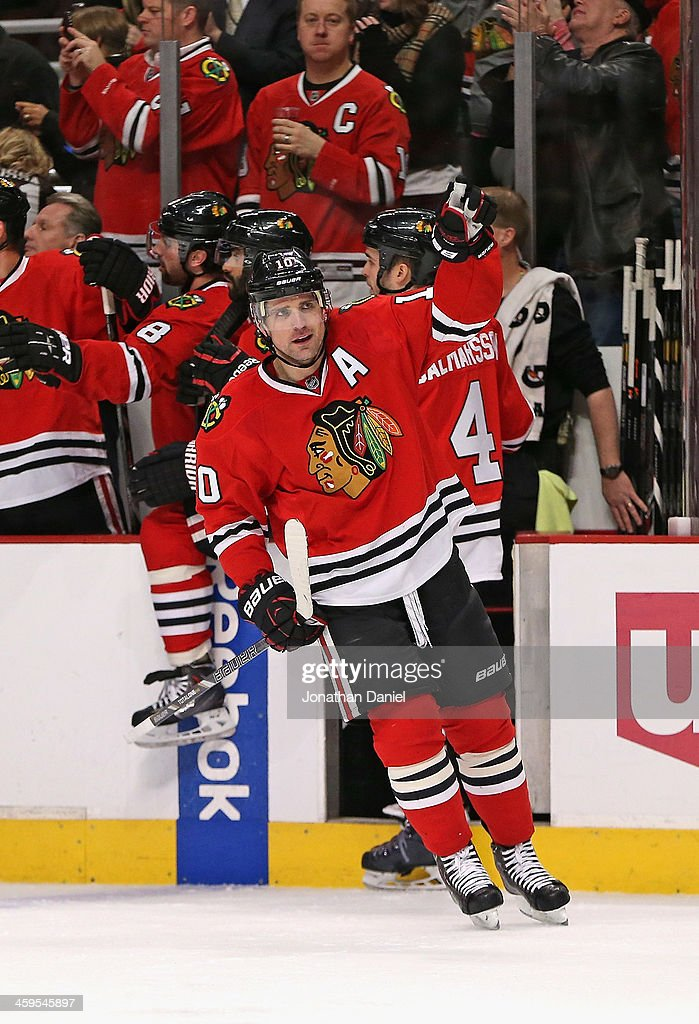 <a gi-track='captionPersonalityLinkClicked' href=/galleries/search?phrase=Patrick+Sharp&family=editorial&specificpeople=206279 ng-click='$event.stopPropagation()'>Patrick Sharp</a> #10 of the Chicago Blackhawks celebrates the first of his two goals in the first period against the Colorado Avalanche at the United Center on December 27, 2013 in Chicago, Illinois.