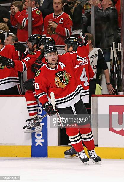 Patrick Sharp of the Chicago Blackhawks celebrates the first of his two goals in the first period against the Colorado Avalanche at the United Center...