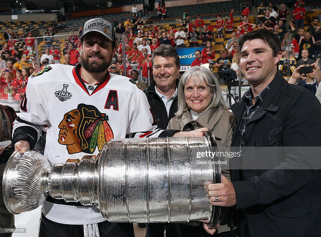 Patrick Sharp #10 of the Chicago Blackhawks celebrates with his family and the Stanley Cup after his team defeated the Boston Bruins 3-2 in Game Six of the 2013 Stanley Cup Final at TD Garden on June 24, 2013 in Boston, Massachusetts. The Chicago Blackhawks won the series 4-2 to win the Stanley Cup.