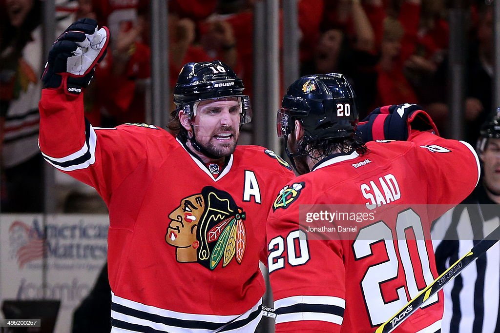 <a gi-track='captionPersonalityLinkClicked' href=/galleries/search?phrase=Patrick+Sharp&family=editorial&specificpeople=206279 ng-click='$event.stopPropagation()'>Patrick Sharp</a> #10 of the Chicago Blackhawks celebrates with teammate <a gi-track='captionPersonalityLinkClicked' href=/galleries/search?phrase=Brandon+Saad&family=editorial&specificpeople=7128385 ng-click='$event.stopPropagation()'>Brandon Saad</a> #20 after scoring a goal against Jonathan Quick #32 of the Los Angeles Kings in the second period during Game Seven of the Western Conference Final in the 2014 Stanley Cup Playoffs at United Center on June 1, 2014 in Chicago, Illinois.