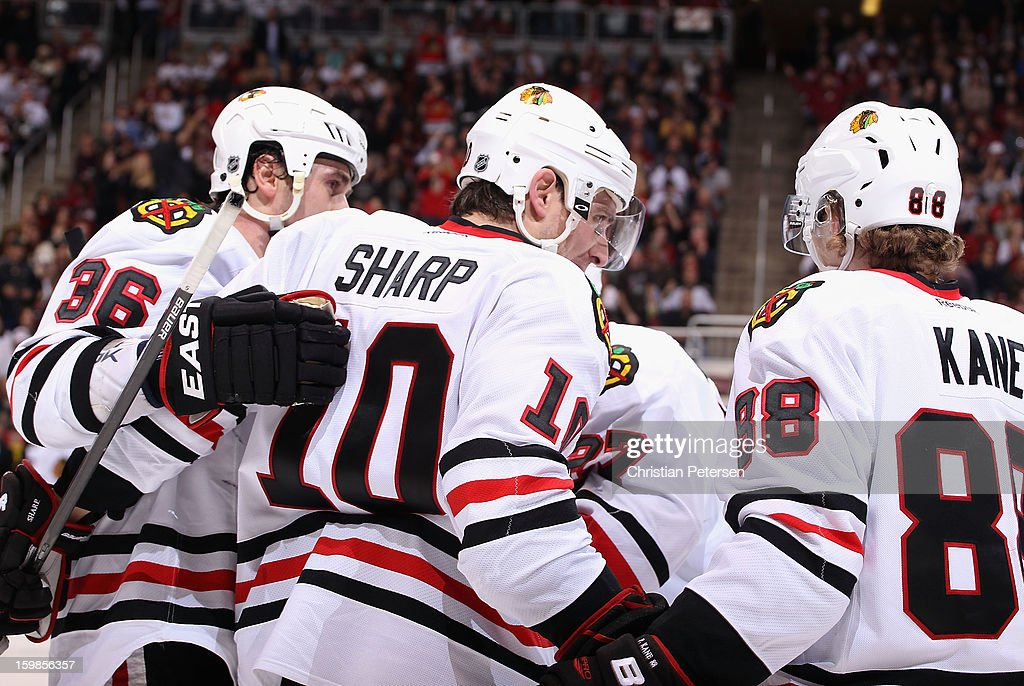 Patrick Sharp #10 of the Chicago Blackhawks celebrates with teammates after scoring against the Phoenix Coyotes during the NHL game at Jobing.com Arena on January 20, 2013 in Glendale, Arizona. The Blackhawks defeated the Coyotes 6-4.