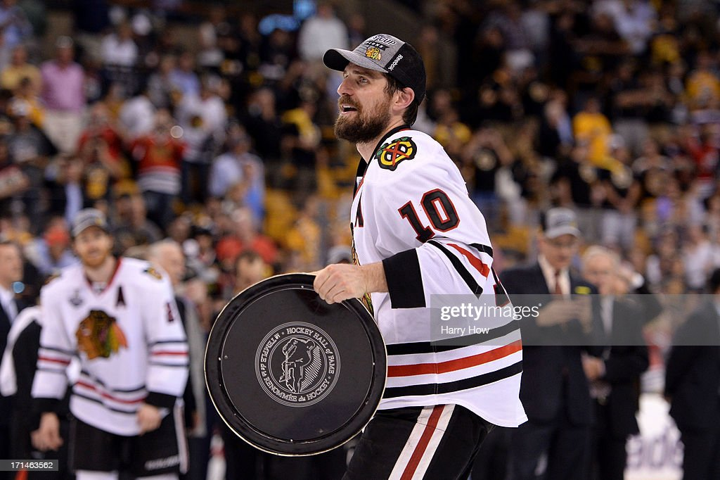 Patrick Sharp #10 of the Chicago Blackhawks celebrates with the Stanley Cup after in Game Six of the 2013 NHL Stanley Cup Final at TD Garden on June 24, 2013 in Boston, Massachusetts. The Chicago Blackhawks defeated the Boston Bruins 3-2 to win the Stanley Cup.