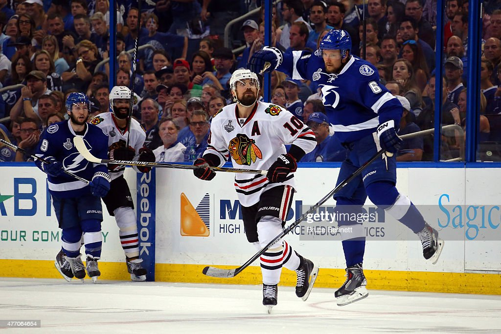 <a gi-track='captionPersonalityLinkClicked' href=/galleries/search?phrase=Patrick+Sharp&family=editorial&specificpeople=206279 ng-click='$event.stopPropagation()'>Patrick Sharp</a> #10 of the Chicago Blackhawks collides with <a gi-track='captionPersonalityLinkClicked' href=/galleries/search?phrase=Anton+Stralman&family=editorial&specificpeople=2271901 ng-click='$event.stopPropagation()'>Anton Stralman</a> #6 of the Tampa Bay Lightning during Game Five of the 2015 NHL Stanley Cup Final at Amalie Arena on June 13, 2015 in Tampa, Florida.