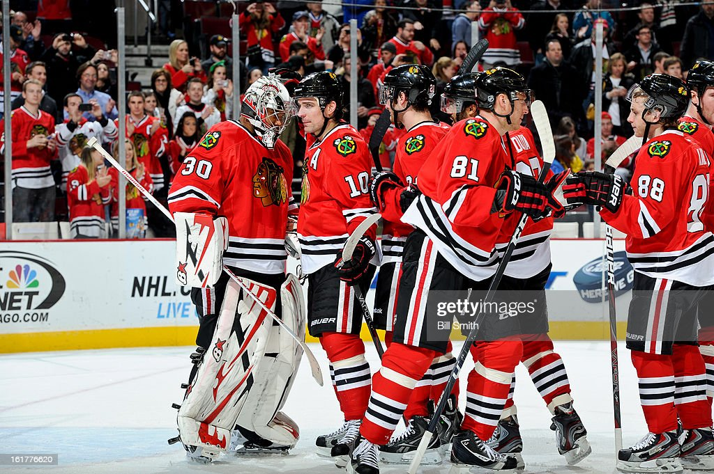 <a gi-track='captionPersonalityLinkClicked' href=/galleries/search?phrase=Patrick+Sharp&family=editorial&specificpeople=206279 ng-click='$event.stopPropagation()'>Patrick Sharp</a> #10 of the Chicago Blackhawks congratulates teammate goalie <a gi-track='captionPersonalityLinkClicked' href=/galleries/search?phrase=Ray+Emery&family=editorial&specificpeople=218109 ng-click='$event.stopPropagation()'>Ray Emery</a> #30 after defeating the San Jose Sharks during the NHL game on February 15, 2013 at the United Center in Chicago, Illinois.