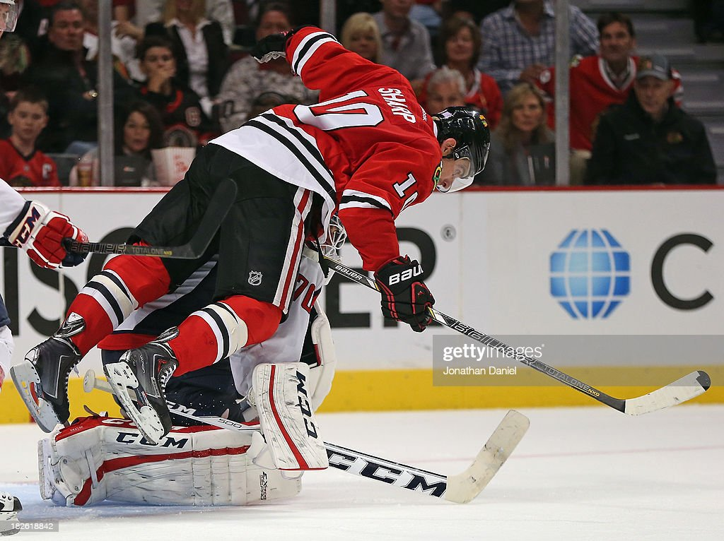 <a gi-track='captionPersonalityLinkClicked' href=/galleries/search?phrase=Patrick+Sharp&family=editorial&specificpeople=206279 ng-click='$event.stopPropagation()'>Patrick Sharp</a> #10 of the Chicago Blackhawks falls over <a gi-track='captionPersonalityLinkClicked' href=/galleries/search?phrase=Braden+Holtby&family=editorial&specificpeople=5370964 ng-click='$event.stopPropagation()'>Braden Holtby</a> #70 of the Washington Capitals and is called for goaltender interference at the United Center on October 1, 2013 in Chicago, Illinois. The Blackhawks defeated the Capitals 6-4.