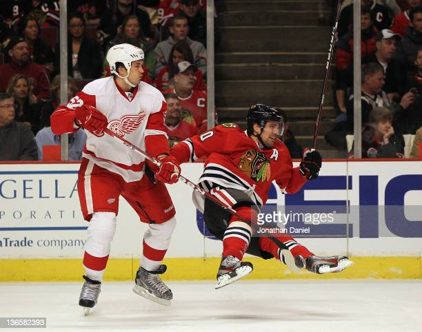 Patrick Sharp of the Chicago Blackhawks flies in air after colliding with Jonathan Ericsson of the Detroit Red Wings at the United Center on January...